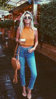 Pin : @morganreidy. my style. retro. loose. orange. jeans. denim. fringe. leather. purse. bag. brown. knit. sunglasses. heels. style. fashion. trend/ trends. 2017. high waisted