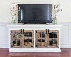 A farmhouse inspired media cabinet with a 2-tone finish. Complete with 4 pane cabinet doors, surface bolt hardware, and crown moulding trim.