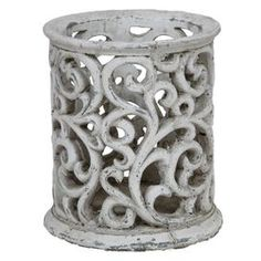 """Ceramic lantern in distressed white with openwork detail.     Product: Hurricane     Construction Material: Ceramic   Color: Cement       Dimensions: 7.5"""" H x 6.5"""" Diameter     Cleaning and Care: Wipe clean with damp cloth"""