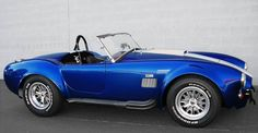 Ten Facts about the AC Cobra: 8. The wire wheels had to be changed out for Halibrand alloy wheels. The original Cobras came with wire wheels, like the Ace, but that was quickly abandoned later on. The Ford 427 engine was so powerful it would deform the wire wheels, which is why Shelby went with Halibrand alloy wheels that were tougher.