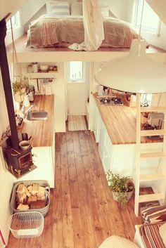 There looks to be plenty of room inside, even with a queen bed in the loft and generously wide wooden countertops in the kitchen. #TinyHouseforUs