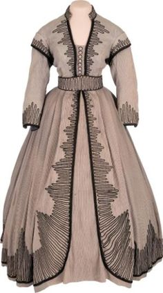 """This undated photo courtesy 1939 film """"Gone With the Wind"""" Outfit for Vivien Leigh as she played Scarlett O'Hara. Sold for $137,000 at auction. Dallas-based Heritage Auctions was offering the gray jacket and skirt featuring a black zigzag applique along with other items from the Academy Award-winning film at an auction in Beverly Hills, California, April 18, 2015. (Emily Clements/Heritage Auctions, HA.com via AP)"""