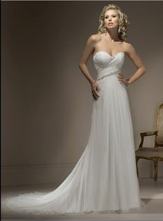 Strapless chiffon bridal gown with sweetheart neckline and corset closure. This style features chiffon delicately edged with gorgeous lines of beaded embellishments through the bodice. Exquisite draping creates the magic of a soft sweeping train. Free made-to-measurement service for any size. Available colors seen as in Color Options.