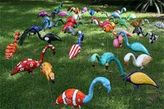 Creative yard deco. What to do with those old pink flamingos!