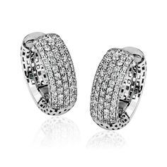 These modern 18k white gold hoop earrings have a rounded shape and a size which is perfect for everyday wear. They contain 1.00 ctw of white diamonds.