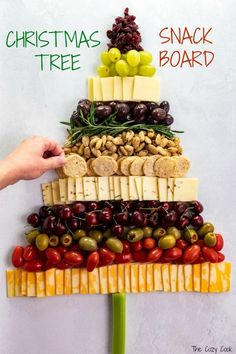 From decadent almonds to savory olives a variety of cheeses and crunchy rice crackers this Christmas Tree Snack Board has it all! Guests will love snacking from this festive board and its so fun to put together! Christmas Cheese, Christmas Party Food, Christmas Brunch, Xmas Food, Christmas Appetizers, Christmas Cooking, Italian Christmas Dinner, Charcuterie Recipes, Charcuterie And Cheese Board