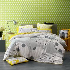 An elegant combination of abstract circles, spots and floral prints in grey and white ensures that Debelle makes a stunning bedroom statement.