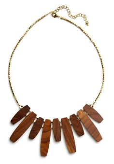 Rays of Sun Necklace. Made by fair trade, handmade practices, this stunning wooden necklace by Mata Traders is a natural representation of the sun's rays, which stream through branches and onto the meadow upon which you lie. #brown #modcloth
