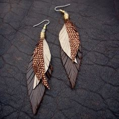 Fleather Earrings - Sparkly Gold, Bronze and Brown Leather Feather Dangly Earrings on Etsy ($38.00)/ Beautiful 'feathers' made from leather to be worn on your ears.