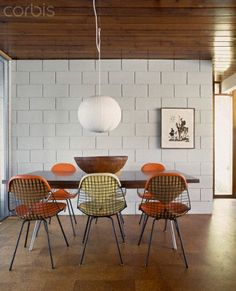 Mixed muted brights and an interesting wall and a George Nelson Ball Lamp
