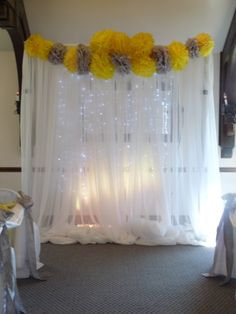 Fun Backdrop with Lights and Yellow and Grey Accents.