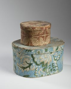 TWO SMALL BAND BOXES WITH FLORAL MOTIFS, ONE WITH LANCASTER, PENNSYLVANIA NEWSPAPER LINING.  Height of largest, 6 inches...