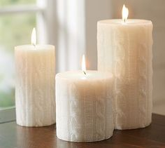The Knitter in Me thinks this is AWESOME! Sparkle Cable Knit Pillar Candle #potterybarn