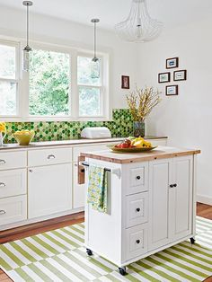 A wheeled island contributes a staging area for dishes en route to the dining room in this cottage kitchen.