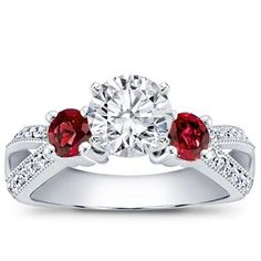 "An engagement ring with Ruby Accents will make her cheeks just a rosy when you pop the big question.  ""Repin"" if this ring would make you blush!"