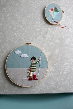 embroidery hoop, applicae.  like the idea of one string leading to another...would be cute to do with a string between 5, to each family member...but the string becomes something else in each hoop