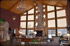 Lobby fireplace and beautiful view at Stafford's Crooked River Lodge  #PetoskeyArea http://www.PetoskeyArea.com