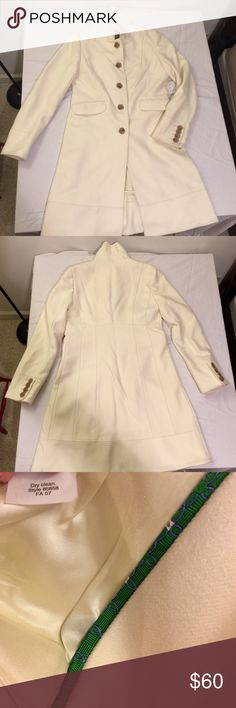 J. Crew Wool Coat 3/4 Length Cream size 8 Beautiful winter white wool coat by j crew. Hits at my knee, ruffle collar, and princess seams for a fitted look. Fully lined. Great condition, one small black scuff. Occurred in storage, probably can be cleaned, did not try to remove it. Hardly noticeable. See photo. Purchased at distribution center outlet, black mark through label to prevent retail return. Wore this one time. J. Crew Jackets & Coats