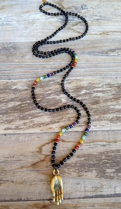 Faceted onyx for soothing, super tiny hand made African trade beads, and Chakra gemstones, on this awesome long necklace with a Mudra solid brass pendant!  #chakras