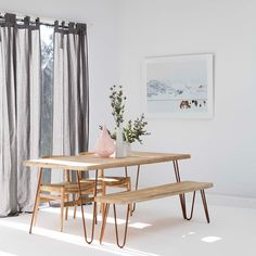 Modern dining table with reclaimed wood top and Hairpin legs. 60\