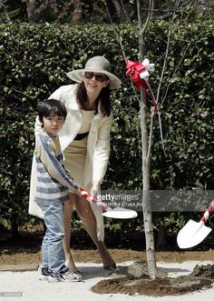 Australian-born Danish Crown Princess Mary (R) helps plant a tree with seven-year-old Yuto Kimura (L) at the Hans Christian Andersen Park in Funabashi city, Chiba prefecture, 19 April 2005. Crown Princess Mary, accompanied by her husband Crown Prince Frederik, is now in Japan to attend the national day ceremony at the 2005 World Expo in Aichi prefecture.