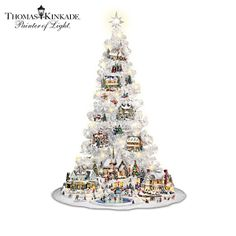 Handcrafted collection re-imagines the Thomas Kinkade Village collection with a pre-lit white tree, village buildings, and ornaments. Christmas Village Collections, Christmas Tree Collection, Indoor Christmas Decorations, Outdoor Christmas, Christmas Ribbon, White Christmas, Thomas Kinkade Christmas, Thomas Kincaid, Christmas Villages