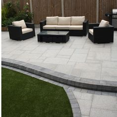 """The winner of """"Best Large Patio Design"""" in our Natural Paving Landscaping Awards 2016 is Tony Ward of Award Landscape! Award Landscapes created a large paved area, providing an outside lounge area and path down to a separate seating area. Garden Slabs, Patio Slabs, Block Paving Patio, Outdoor Paving, Patio Roof, Concrete Patio, Garden Path, Design Patio, Back Garden Design"""