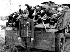 Franz Hössler was an SS-Obersturmführer and Protective Custody Leader at the Auschwitz-Birkenau, Dora-Mittelbau and Bergen-Belsen concentration camps. In this photo, he is standing in front of truck full of corpses at Bergen-Belsen. The purpose of the microphone is unclear.Hössler  was tried alongside 43 other SS in the Bergen Trial. He was found guilty and hanged on Dec 13, 1945.
