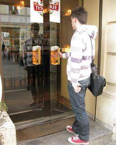 Tyskie Beer Door Handles | Beer mug stickers were installed behind doors of restaurants, pubs and shops as a part of creative Tyskie beer advertising campaign.