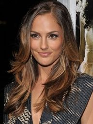 Minka Kelly's long, wavy layers are fit for a Charlies Angel. Get the look using a large barrel curling iron and letting hair cool for 10 minutes before brushing through