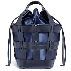 Inspired by bucket bags and totes, Trademark designed The Cooper bag with a caged leather construction plus a lustrous satin compartment for a hybrid appeal. …