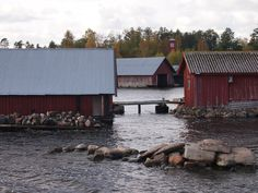 Island in Finland....I'm kind of found those red boathouses.