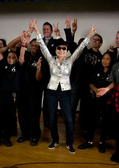 Yoko Ono and a few new friends bring peace to a John Lennon Educational Tour Bus event on Sept. 15 in New York