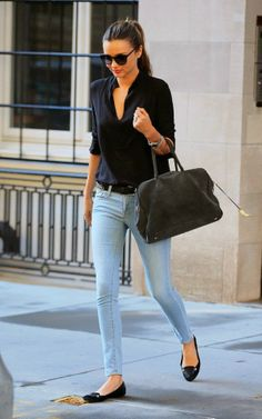 Black blouse with sky blue casual jeans and dark medium taupe leather hand bag and shining black cute pumps