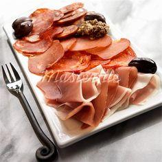 Tapas Platter with Jamon Serrano, Pamploma, Lomo, Soria, Picante Sausage and Black Olives Stock