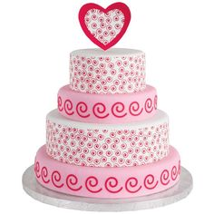 Swirling Dervish Cake - A treat for the heart and soul, this four-tiered cake is meant to impress. Use swirl-patterned Sugar Sheets! and punch inserts to festoon every layer with freewheeling forms.