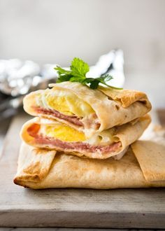 No Washing Up Ham Egg Cheese Pockets - Place ham on a wrap/tortilla, top with a ring of shredded cheese, crack an egg inside, wrap with foil and bake. Voila! A hot breakfast pocket! www.recipetineats.com