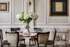 Cocktails and hydrangeas. What more do we need? Oh ok the dining chairs and wall panelling are pretty special too.
