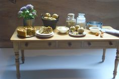 my favorite piece of furniture: table made by Jane Newman. I want to fill the drawers with all kind of things we have in those kitchen drawers in RL, although we say we ordened them.