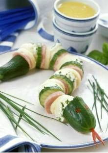 Snake made of cucumber, sausage, cheese, and bread with Boursin--sew it together and use red bell pepper for eyes/tongue.