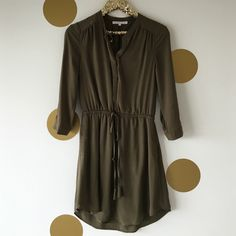 Olive Green Shirtdress This olive Shirtdress features 3/4 length sleeves, drawstring waist. So comfortable and looks great with brown boots! Only worn twice, great condition. Size Small Daniel Rainn Dresses Long Sleeve