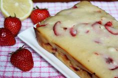 Lemon Strawberry Yogurt Loaf  - 1 1/2 cups of all-purpose flour  - 2 tsp of baking powder  - 1/2 tsp of salt  - 3/4 cup of plain low fat Greek style yogurt  - 3/4 cup of sugar  - 1 Tbsp honey  - 1/2 cup of fresh lemon juice  - 1 tsp of almond extract  - 3 large egg whites  - 2 tsp of lemon zest  - 1/4 cup of vegetable oil  - 2 cups of fresh strawberries, small slices