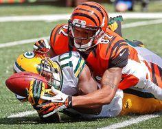 Green Bay Packers kick returner Jeremy Ross (10) fumbles a kickoff as he is hit by Cincinnati Bengals' Marvin Jones