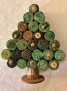 """CORK THERAPY wine cork Christmas Tree. This 7"""" x 5"""" tree will look great sitting on your mantle or desk at work during the holiday season, or would be a perfect gift from your secret Santa! Each of these trees are unique, using different corks and embellishments. The corks are dyed prior to assembly to give them a more natural look, verses using paint like other sellers do. So the tree you receive will be slightly different that the picture. XX50"""