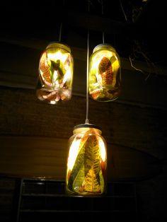 Flamp: scenic pendant, with jars under vacuum. Federica Di Donato with Sergio Altenkirch  F&F collection.