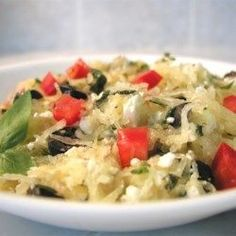Spaghetti Squash I Recipe and Video - Strands of baked spaghetti squash tossed with feta cheese, onions, tomatoes, olives, and basil for a Greek-inspired dish that tastes like pasta without all the calories. Veggie Recipes, My Recipes, Vegetarian Recipes, Cooking Recipes, Healthy Recipes, Lunch Recipes, Free Recipes, Cooking Tips, Recipies