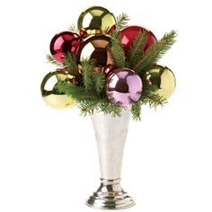 Christmas Centerpiece: Stick multicolored ornaments onto trimmed wooden skewers and arrange them like a bouquet in an opaque vase. Use tree or wreath clippings to fill in any gaps.