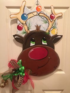 Reindeer door decoration lights the way to a festival Christmas! Welcome your guest with this charming Reindeer Door decoration. This hand-painted original desi