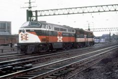 New Haven Railroad DER- 4 FM CPA-24-5 locomotive # 794 & DER-3a ALCO PA-1 locomotive # 0785, are seen under wire on the mainline in New Haven, Connecticut, late 1950's, Mac Seabree Collection