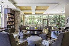 PHOTO TOUR: Texas Health Cancer Center | Healthcare Design --- Warm fireplaces, built-in bookcases, lounge seating, and views to nature are located throughout to convey a sense of respite and coziness. Photo: Daryl Shields/HKS Inc.